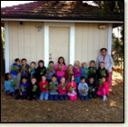 Kristi Draluck and her kindergarten class in front of the new garden shed